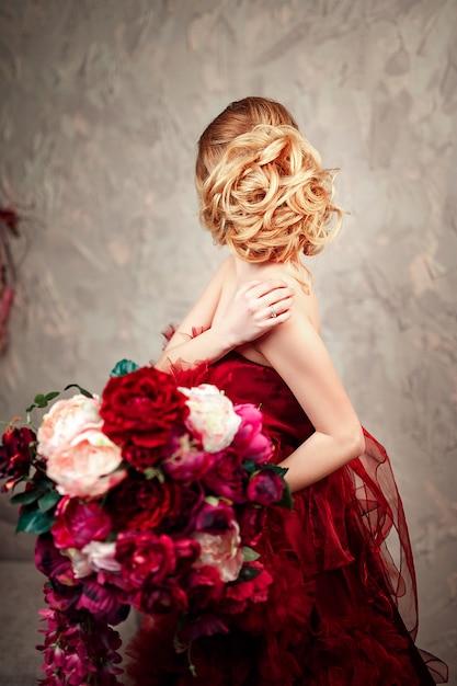 Sexy stylish blonde beautiful woman on the sofa Premium Photo