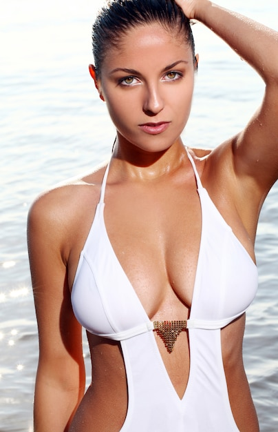 Sexy woman on the beach Free Photo