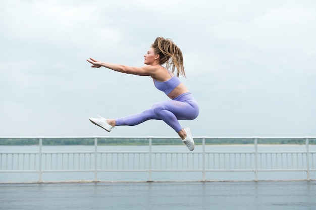 Sexy woman jumping long shot Free Photo