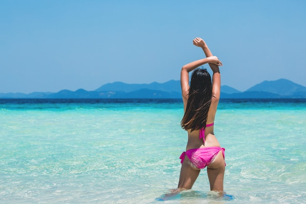 Sexy woman relax on tropical beach Premium Photo