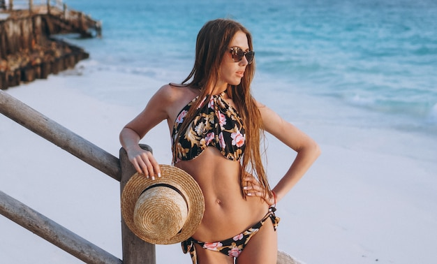 Sexy woman in swim wear by the ocean Free Photo