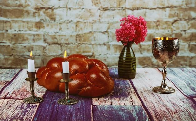 Shabbat shalom - traditional jewish sabbath challah and wine ritual Premium Photo