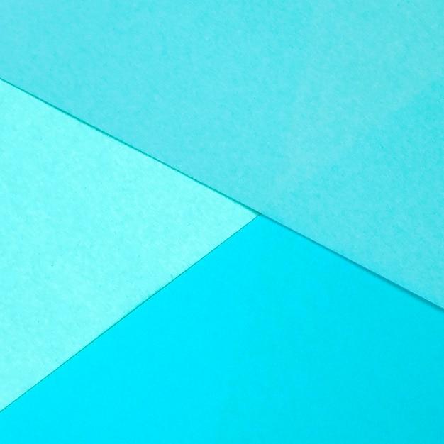 Shade of blue paper geometric flat lay background Free Photo