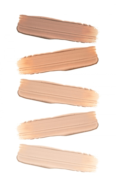 Shades of foundation on white background. Premium Photo
