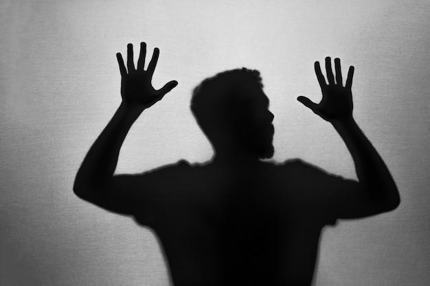 閉じ込められた男性の影 無料写真