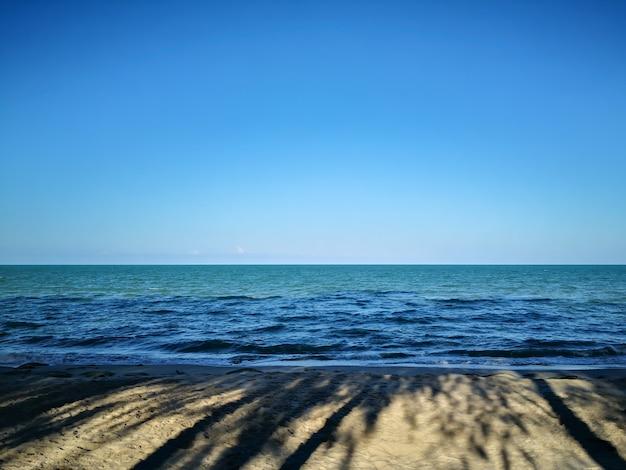 The shadows of morning sun beach Premium Photo