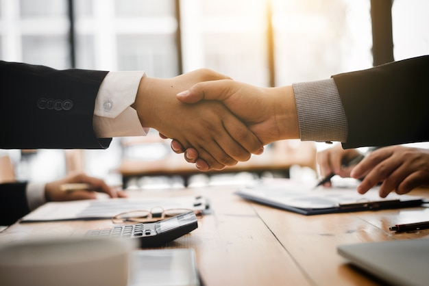 Shaking hands after agree to contracting partner for import product. Premium Photo