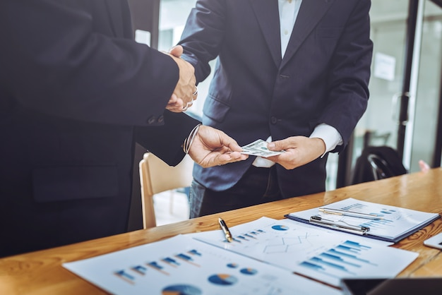 Shaking hands working together two business man. Premium Photo