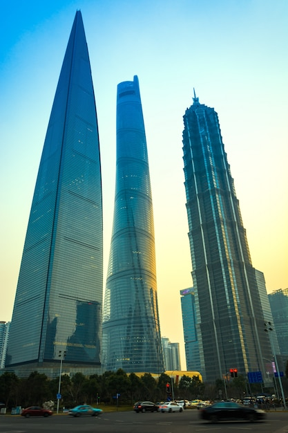 Shanghai, china: october 9, 2015. shanghai world financial centre, shanghai tower and jin mao tower at lujiazui district in shanghai. shanghai tower is newest and the tallest. (632m). Premium Photo