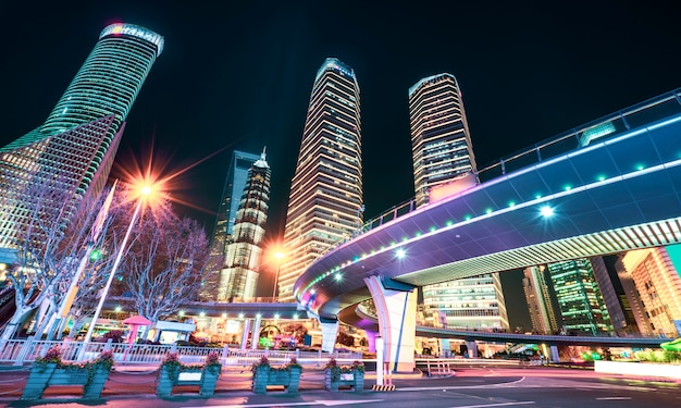 Shanghai city buildings at night and blurred car lights Premium Photo