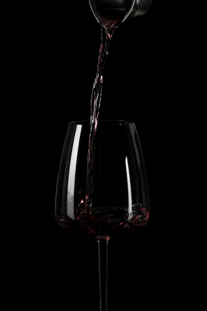 Shape of pouring wine in the dark Free Photo