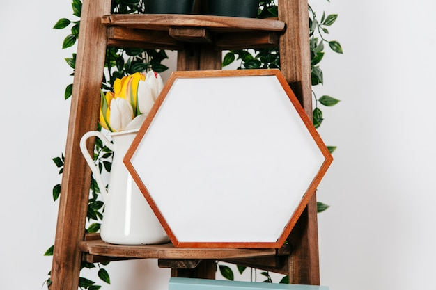 Shaped frame on shelf of stand Free Photo
