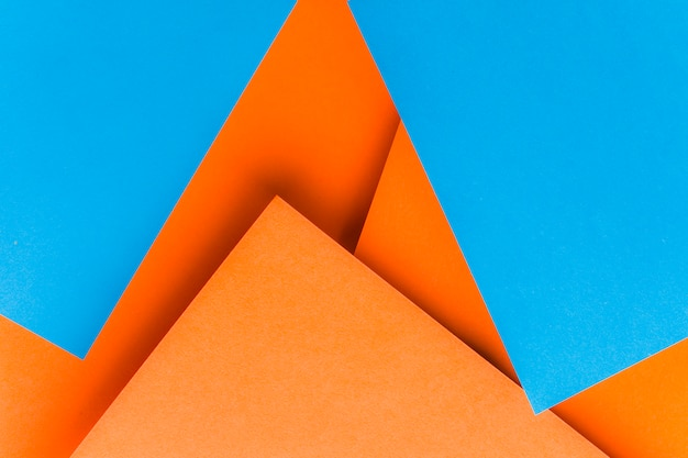 Shapes made with blue and an orange card paper Free Photo