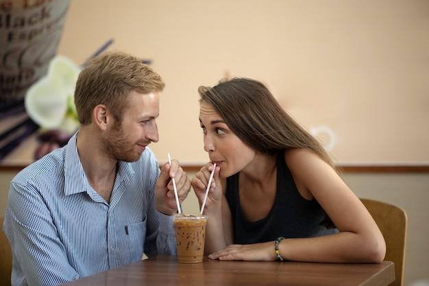 Sharing milkshake Free Photo