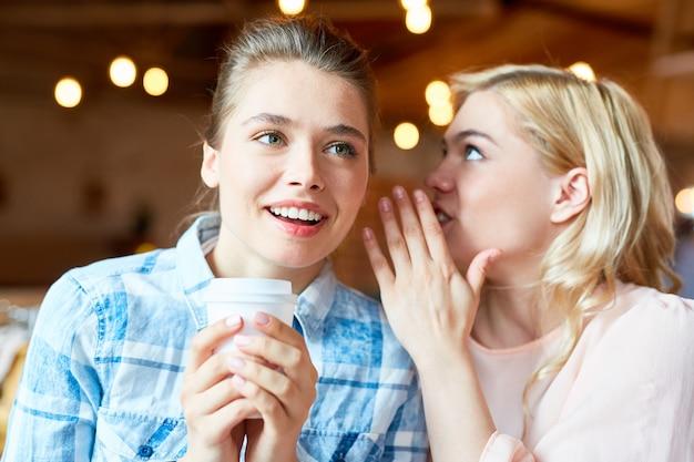 Sharing secret with best friend Free Photo