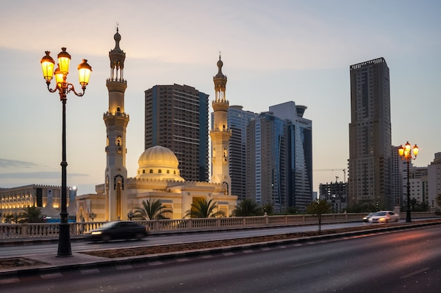 Sharjah. evening al qasba mosque in the urban streetscape. Premium Photo