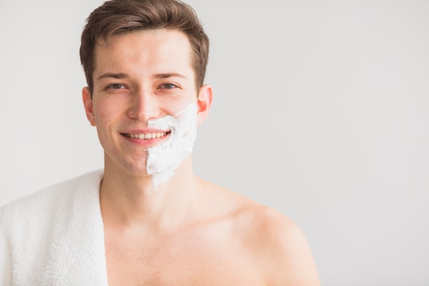 Shaving concept with attractive young man Free Photo