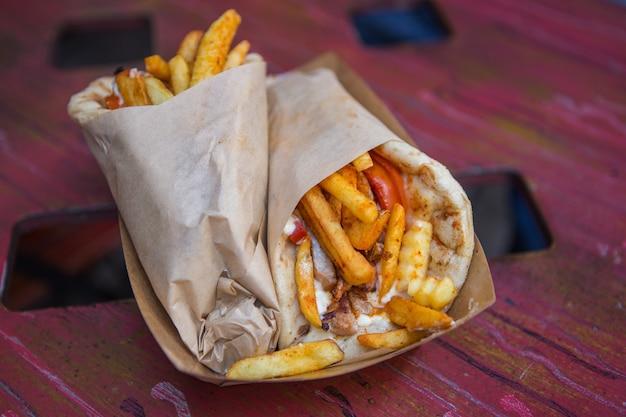Shawarma, gyros. traditional greece, greek meat food, closeup view, Premium Photo