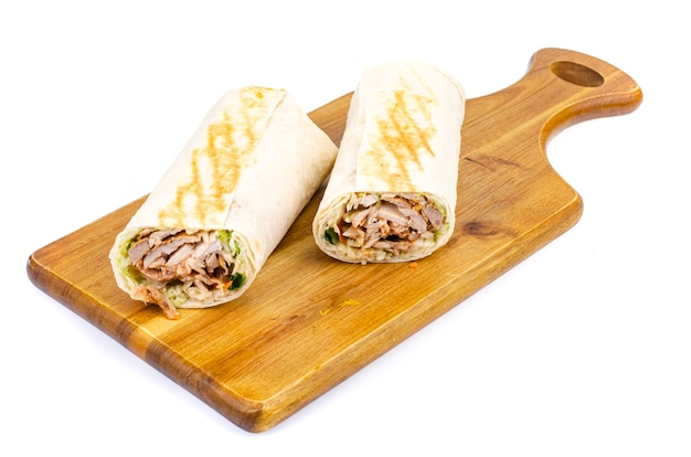 Shawarma, lavash with meat and vegetables. Premium Photo