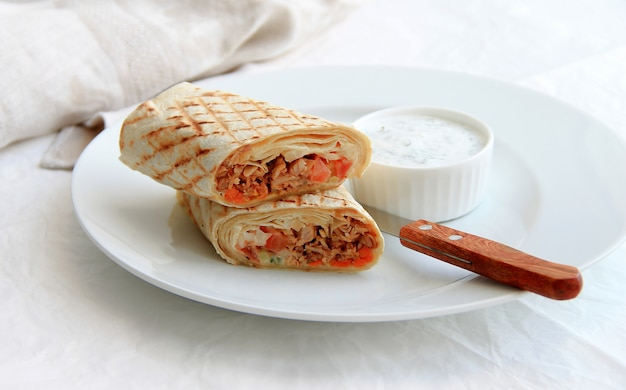 Shawarma with meat in a white plate Premium Photo