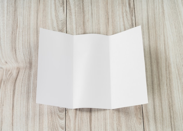 Sheet of paper folded over white Free Photo