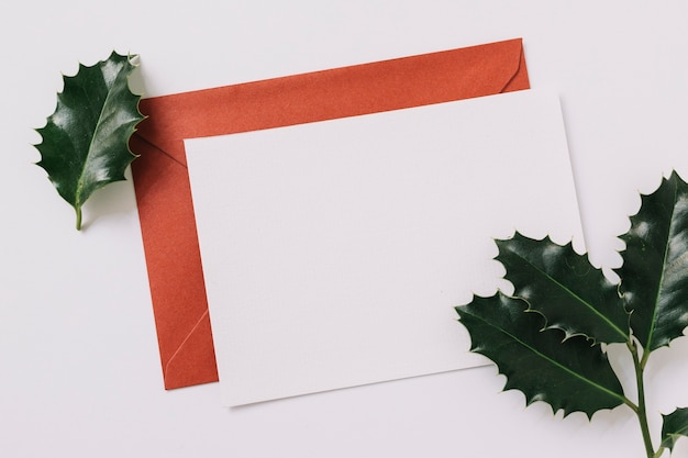 Sheet of paper with envelope on table Free Photo