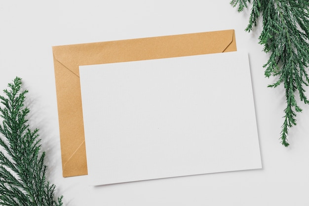 Sheet of paper with yellow envelope on table Free Photo