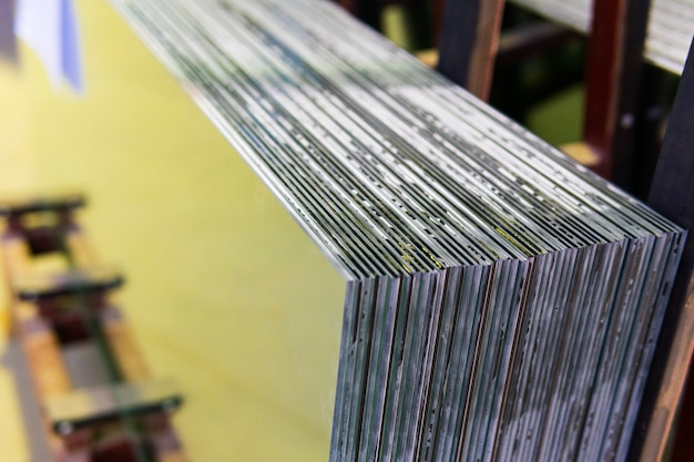 Sheets of factory manufacturing tempered clear float glass panels cut to size Premium Photo