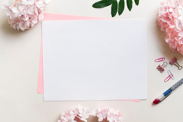 Sheets of paper surrounded by flowers Premium Photo