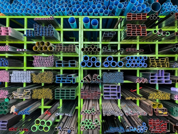 Shelves of different metal products and pvc tubes Premium Photo
