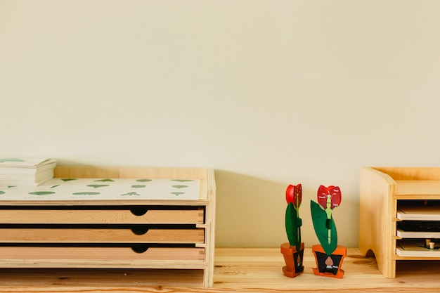 Shelves with wooden educational material in a montessori school. Premium Photo