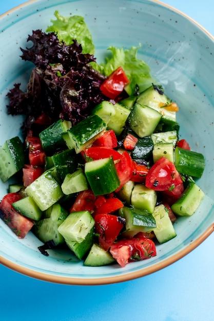 Shepherd salad mixed with herbs Free Photo
