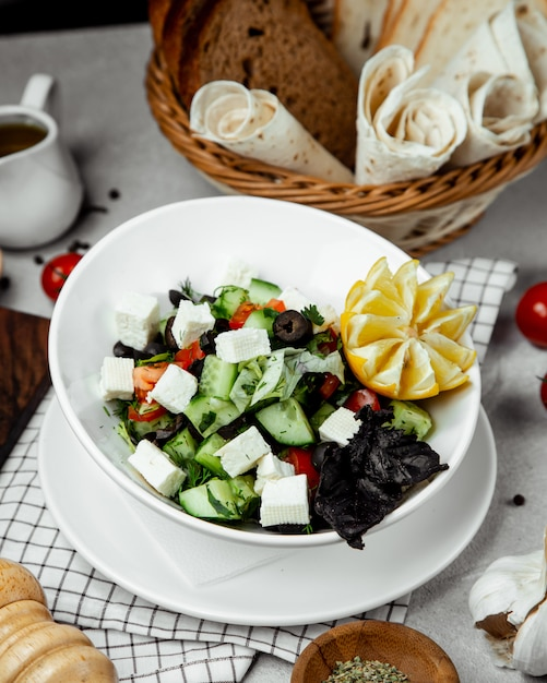 Shepherd salad topped with cheese Free Photo