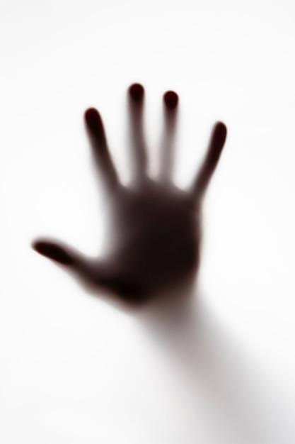 Shillouette of a persons hand on white Premium Photo