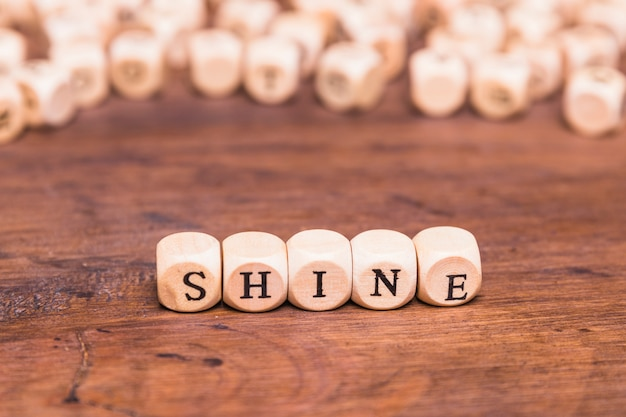 Shine word made with wooden cubes Free Photo