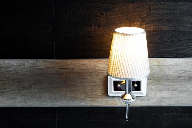 Shining lamp in bedroom Premium Photo