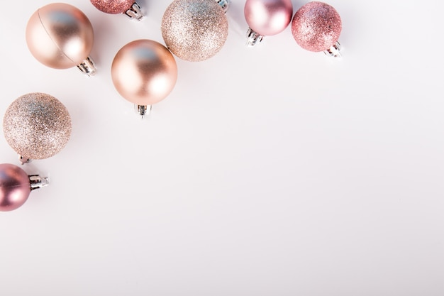 Shining pink baubles on white Free Photo