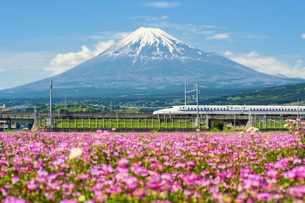 Shinkansen bullet train at mountain fuji Premium Photo