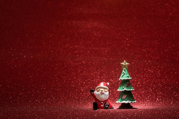 Shiny background with santa claus and a christmas tree Free Photo