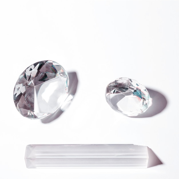 Shiny diamond in round and prism shape on white background Free Photo