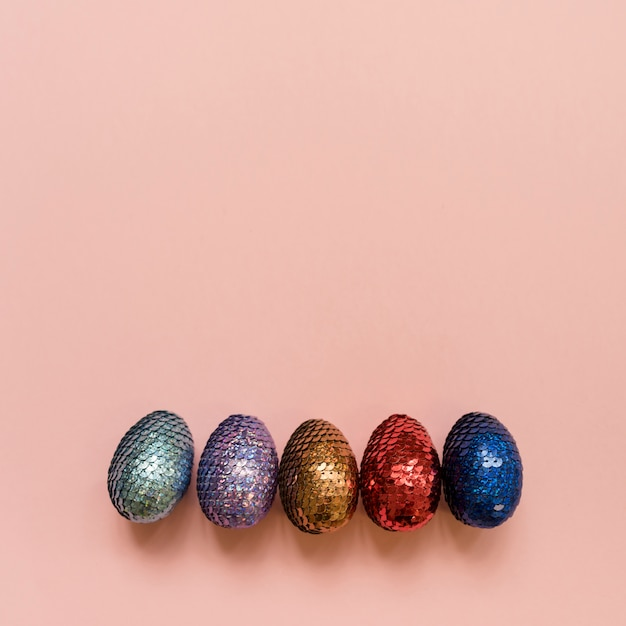 Shiny easter eggs on table Free Photo