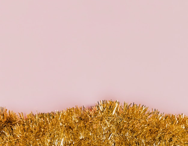 Shiny golden tinsel for new years party Free Photo