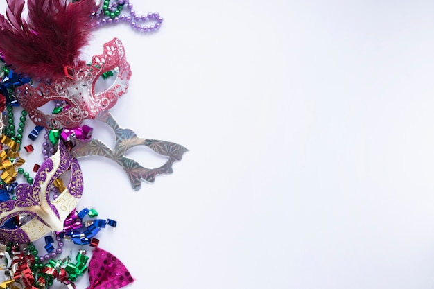 Shiny masks on confetti Free Photo