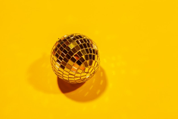 Shiny party disco balls shining in a day light over color background Premium Photo