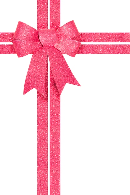 Shiny pink gift bow with ribbon isolated on white. Premium Photo