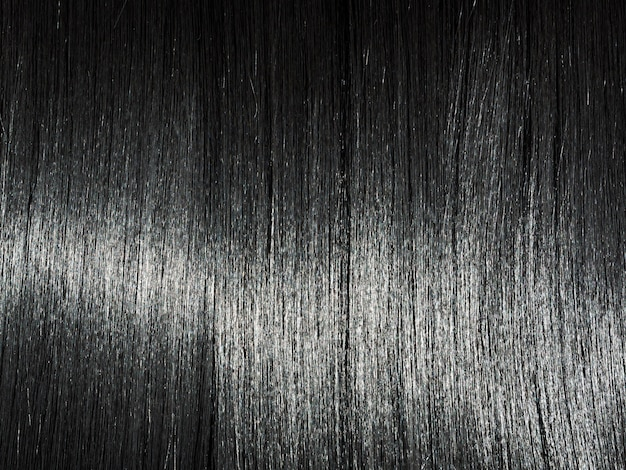 Shiny straight black hair background. beautiful smooth brunette hair Premium Photo
