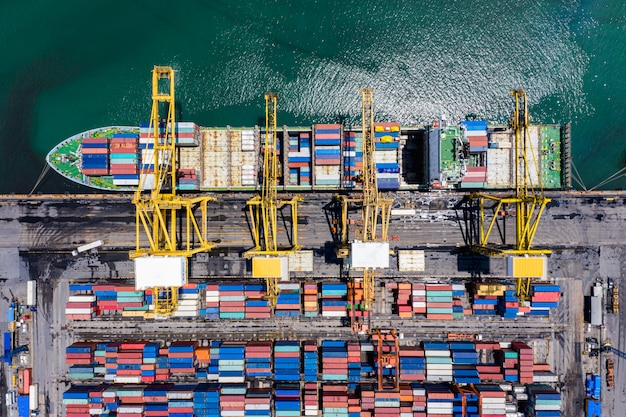 Shipping cargo containers loading and unloading Premium Photo
