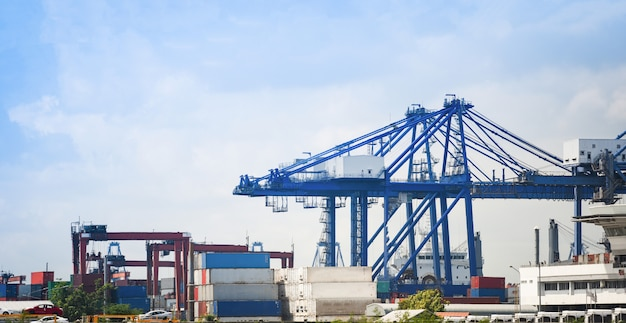 Shipping cargo crane and container ship in export car import and logistics industry water transport Premium Photo