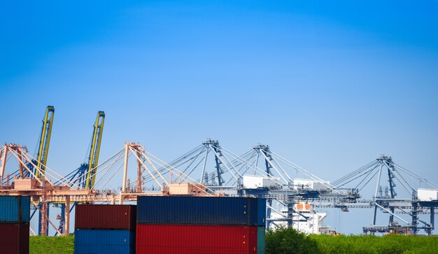 Shipping cargo crane and container ship in export and import business and logistics in harbor industry and water transport Premium Photo