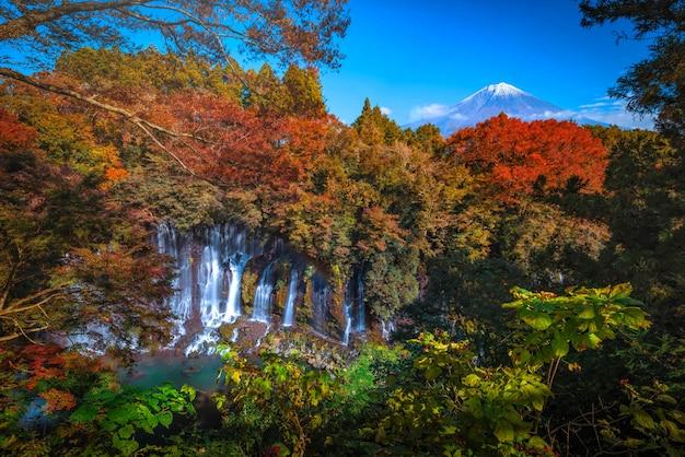 Shiraito falls with mt. fuji and colorful autumn leaf in fujinomiya, shizuoka, japan. Premium Photo
